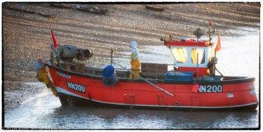 Man Clambers Aboard