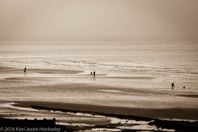 sepia-beach-and-three-men
