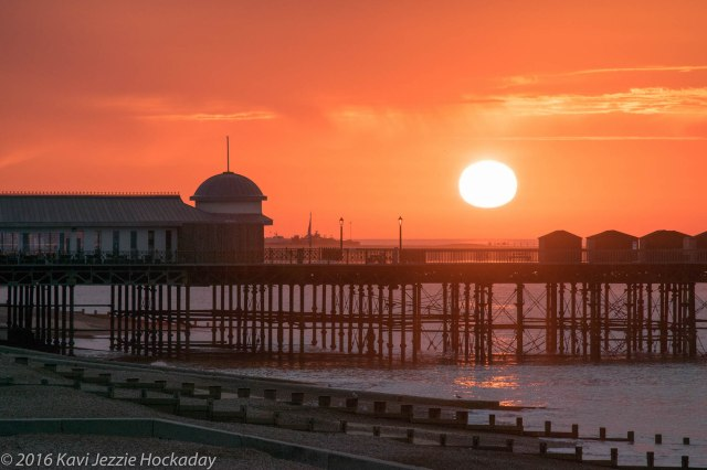 sun-over-pier
